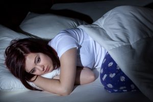 how much sleep does your teenager really need - tired female teenager